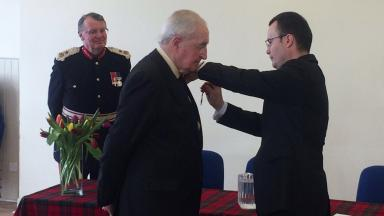 Honour: The French Consul General presents William B. Robertson with the medal.