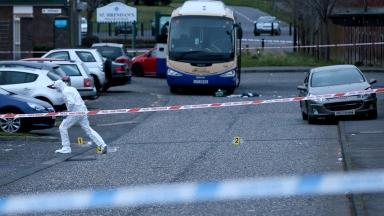 A police forensic officer at the scene of the shooting.