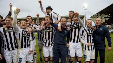 Champions: Dunfermline celebrate their triumph.