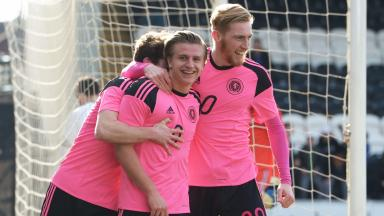 Jason Cummings celebrates putting Scotland ahead in Paisley.