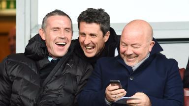 Watching the Scotland U21s play, David Weir (left) and John Collins (centre) react to Jason Cummings' pants display.