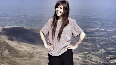 Sarah Albone: At the top of Brecon Beacons on a previous climb.