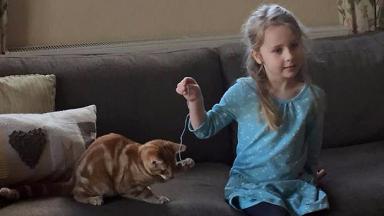 Eliza Adamson-Hopper with her cat mittens.