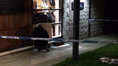 Raid: Car driven through window at golf club.