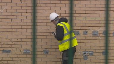 Closures: Engineers carry out work on one of the buildings.