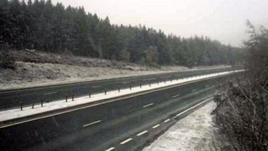 A9: Snow falling on road at Slochd near Carrbridge in the Highlands.