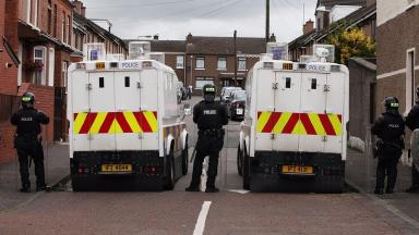 PSNI officers and vehicles in Belfast