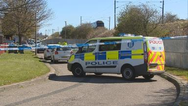 Body: There was an extensive police presence at the scene.