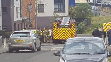 Scene: Emergency services worked to minimise the threat to residents.