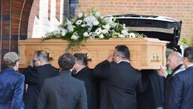 Funeral: David Gest's coffin is carried into the crematorium.