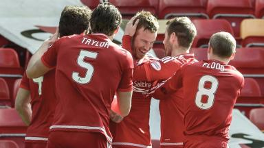Mixed afternoon: Adam Rooney scored before suffering injury.