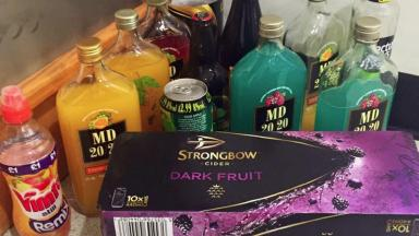 Seized: Police remove haul of alcohol from underage drinkers.