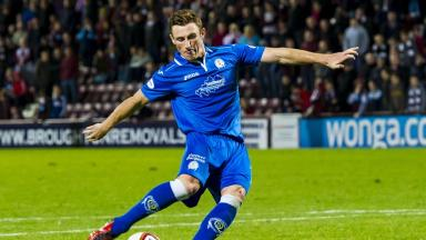Footballer: Chris Mitchell in action for Queen of the South.