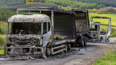 Torched: The lorries were found ablaze in layby near Huntly.