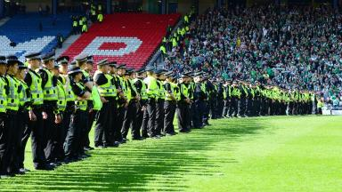 Clash: Police on the pitch after the invasion on May 21.