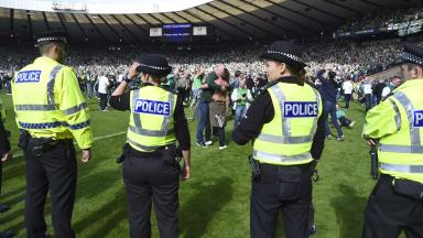 Cup final: Police on pitch after Rangers v Hibernian pitch invasion.