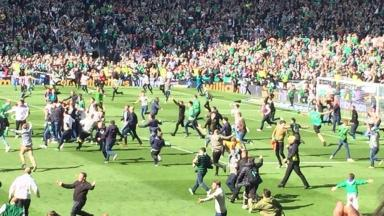 Cup final: Fans run on to the pitch at Hampden.