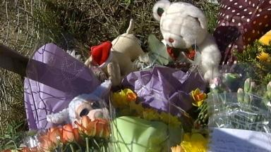 Tributes: Flowers and toys outside the Fife house where Liam was found dead.