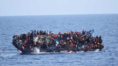 Capsized: The overcrowded boat off the coast of Libya on Wednesday.