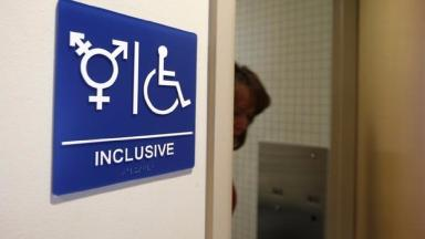 A toilet sign for transgender use
