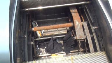 The repairman was freed from the escalator after falling in