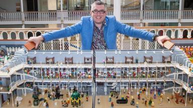 Warren Elsmore with Lego model of National Museum of Scotland.