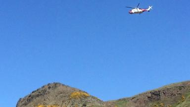 Rescue: Coastguard helicopter is assisting the efforts on Arthur's Seat.