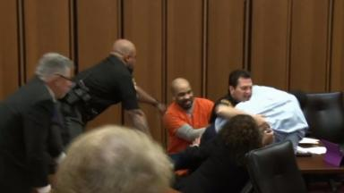 Van Terry lunged at convicted serial killer Michael Madison during the hearing.