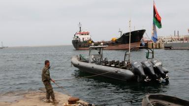 A member of the Libyan coastguard checks a rescue boat