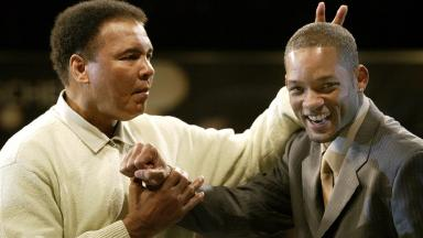 Muhammad Ali and Will Smith, seen in 2003, two years after the actor played the fighter on screen in Ali.