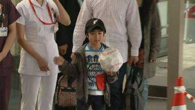 Yamato Tanooka was greeted by cameras and cheers when he left hospital.
