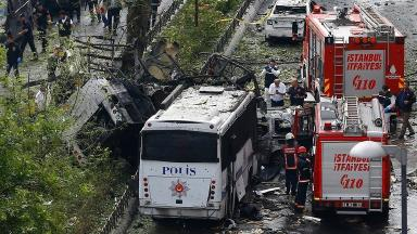 Fire engines stand beside a Turkish police bus targeted in a bomb attack in central Istanbul.