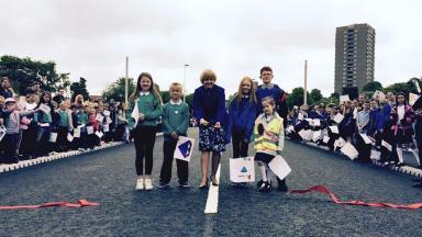 Diamond Bridge: Council leader Jenny Laing opens bridge with help of schoolchildren.
