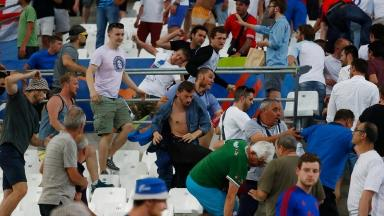Fans clash after England's game with Russia.