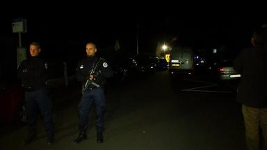 Armed officers outside the victims' home.