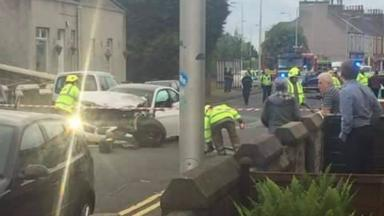 Crash: The BMW was badly damaged after the incident.