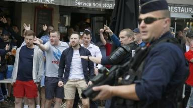 England and Wales fans react after a confrontation with Russia supporters in Lille.