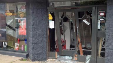 Out There: Shop's door was smashed in.