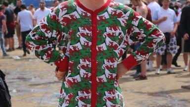 Owen Midha was lent the Welsh dragon onesie by a friend after he lost his luggage.