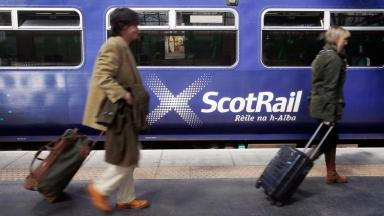 Scotrail train and two passengers. Uploaded June 19, 2016.