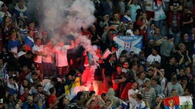 Fans light flares during Russia's match against Slovakia.