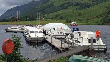 Caledonian Canal: Boat covered with canopy after blast.