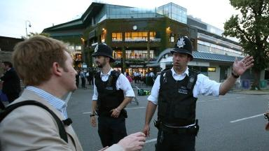 Police instruct spectators away from Wimbledon in 2015.