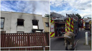 Emergency response: Firefighters stopped the kitchen blaze from spreading.
