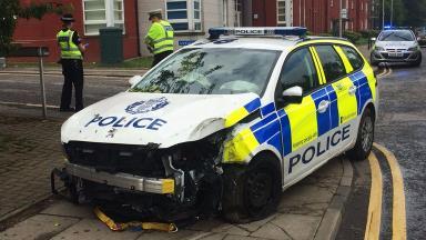 Crash: Police car had blue lights and sirens on.