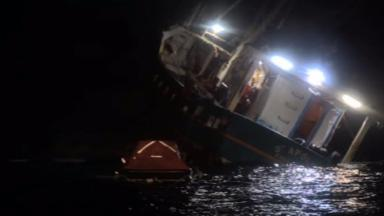 St Apollo: Scallop dredger lists on its side during sinking.