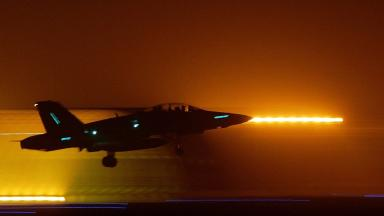 Freedom fighters: U.S. Marine F18 departs base for operation over Iraq.