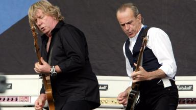 Status Quo: Rick Parfitt, left, on stage with bandmate Francis Rossi.