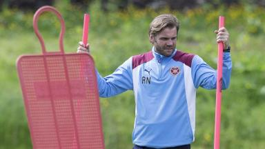 Feeling heat: Robbie Neilson puts the players through their paces this week