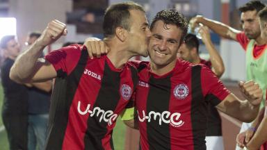 Lincoln Red Imps' Lee Casciaro (right) and Roy Chipolina celebrate at full time.